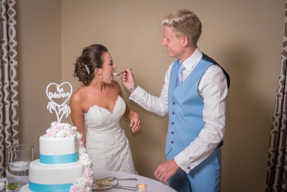 Wedding Cake Cutting Photo – Bride Eats the Cake