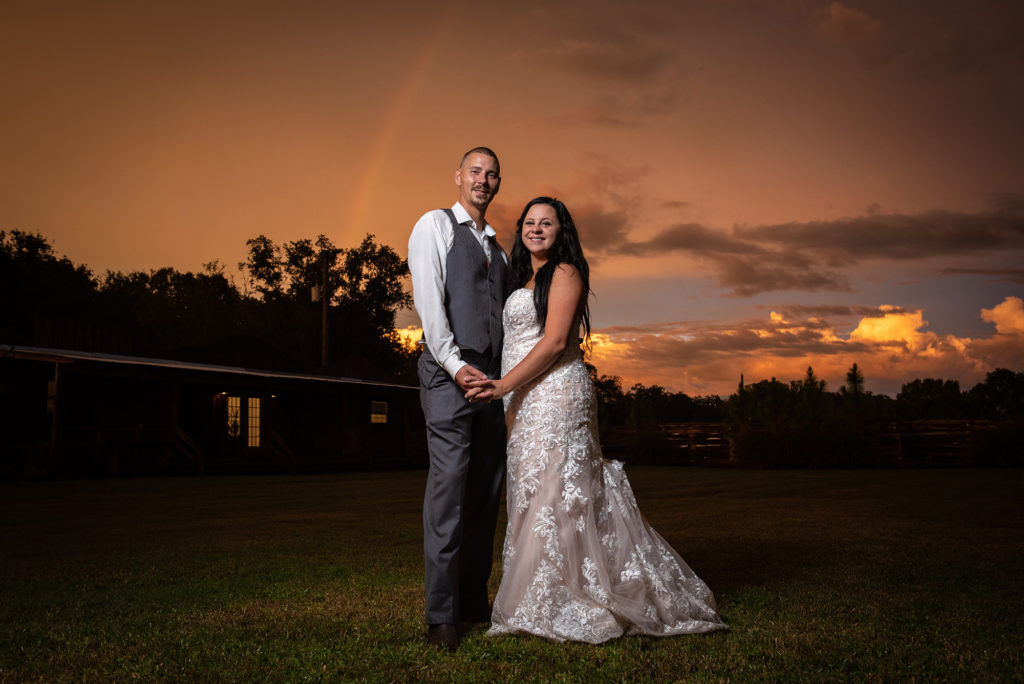 Sunset Rainbow Wedding Photo at a Rustic Barn
