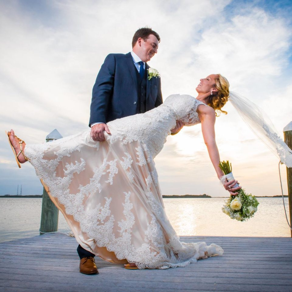 Bride and Groom Dipping on a Dock